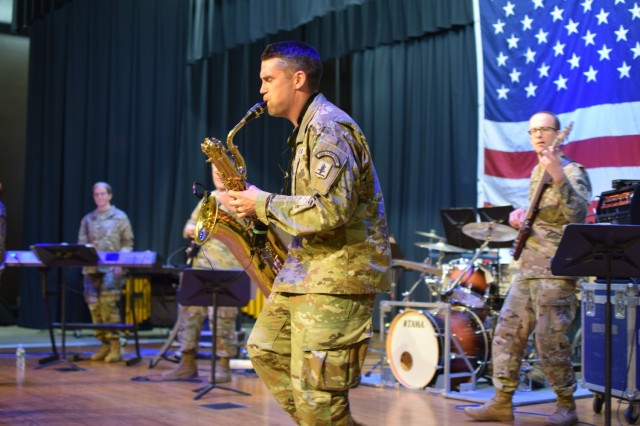 Sgt. Kyle Cartwright plays the saxophone at a concert at the last stop on the summer tour June 17, 2021 in West Point, Nebraska. The Nebraska National Guard 43rd Army band toured several cities in eastern and northeastern Nebraska from June 10-17, 2021 during their annual summer concert tour. (Nebraska National Guard photo by Maj. Scott Ingalsbe)