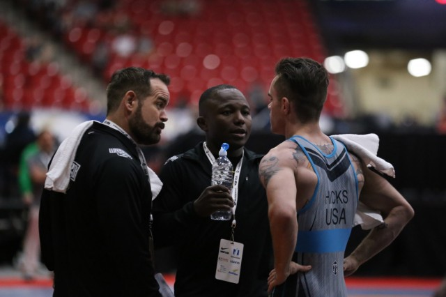 Staff Sgt. Spencer Mango, center, coaching a WCAP Soldier-athlete at the 2019 Las Vegas Marine Corps Open. Mango was named as a coach on the Team USA wrestling delegation for the 2020 Summer Olympic Games in Tokyo Japan. The games start July 23 and run until Aug. 9.