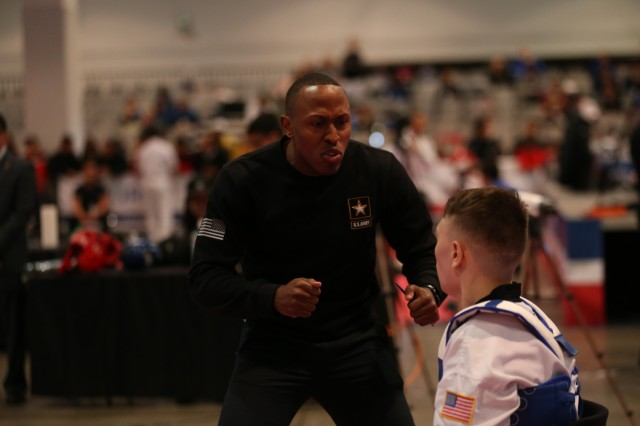 Sgt. Terrence Jennings coaching Sgt. Charles Buset at 2019 Taekwondo Open in Las Vegas, Nevada. Jennings was named one of two taekwondo coaches for the 2020 Summer Olympic Games in Tokyo, Japan. Photo by Brittany Nelson, IMCOM Public Affairs