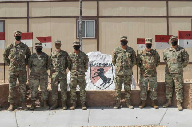 The 11th Armored Cavalry Regiment Field Feeding Team representing the National Training Center poses in front of the 11th Armored Cavalry Regimental Headquarters, April 7th, 2021, Fort Irwin, Calif.   A total of six Regimental Support Squadron Soldiers performed as a team in this year's Philip A. Connelly Field Kitchen Competition to represent the National Training Center: Sgt. Donald Previty, from Buffalo, New York; Sgt. Carolina Sanchez, from Orange County, California; Spc. Michael Groves, from New Smyrna Beach, Florida; Spc. Cheeto Rafanan, from Dededo, Guam; Spc. Courtney Roseborough, from Port La Cruz, Trinidad and Tobago; and Spc. Teyona Jones, from Hampton, South Carolina.  (U.S. Army photo by Spc. Gower Liu, 11th ACR Public Affairs Office)