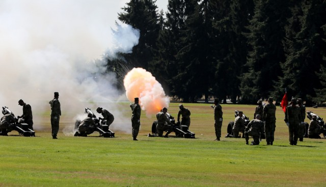 Members of Joint Base Lewis-McChord's salute battery, from Battery C, 1st Battalion, 37th Field Artillery, fire volleys in honor of general officers during the Regional Health Command-Pacific change of command, July 26, 2021.
