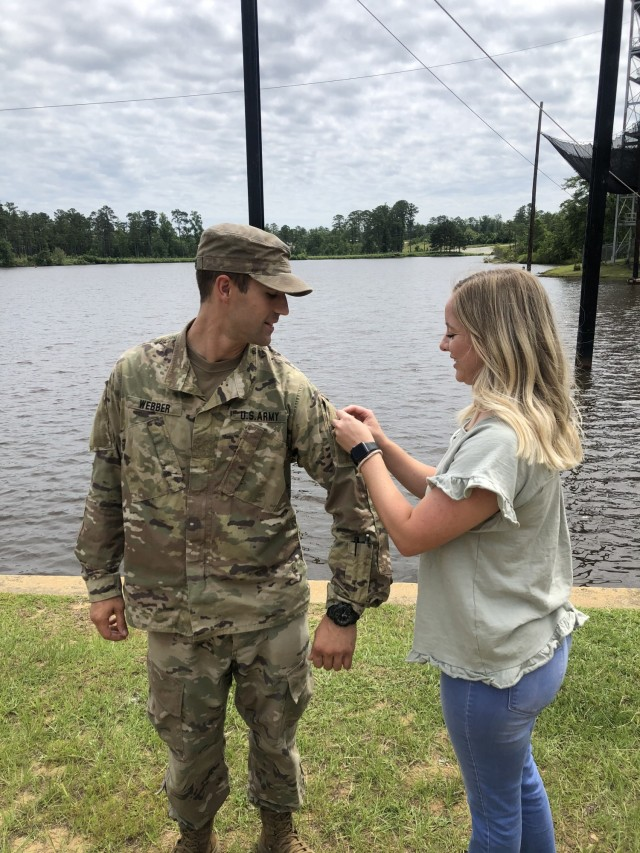 1st Lt. Conner Webber assigned to 3rd Battalion, 15th Infantry Regiment, 2nd Armored Brigade Combat Team, 3rd Infantry Division, is pinned by his spouse Jordan Webber after earning the prestigious Ranger Tap at Fort Benning, Georgia, June 25, 2021. (Courtesy Photo)