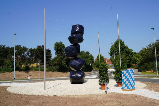 """At the crossroad of Haager Weg, Gailoher Haupstrasse and Von-Scheffel-Strasse, a new traffic circle was revealed on July 22, 2021. Showcased is a sculpture titled, """"Connected,"""" by artists Hannah Regina Uber and Robert Diem. (Photo by Natalie Simmel / USAG Bavaria Public Affairs Intern)"""
