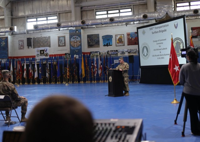 The outgoing commander of the 595th Transportation Brigade (SDDC), Col. Michael E. Ludwick, told his troops and guests at the brigade's July 6, 2021 change of command ceremony held at Camp Arifjan, Kuwait, that all of his accomplishments during his tour were because of his 595th and Military Surface Deployment and Distribution Command family. Ludwick relinquished command to Col. Ricardo L. Sierra-Guzman, whose most recent assignment was as the executive officer for the Fort Bragg, N.C., based 3rd Sustainment Command (Expeditionary). (U.S. Army photo by Staff Sgt. Neil W. McCabe)