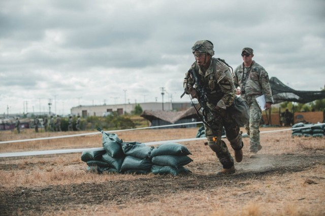 """Sgt. Mark Lopez, 3rd Armored Brigade Combat Team, 1st Cavalry Division, rushes to a firing position during the patrolling portion of the coveted Expert Soldier Badge (ESB) and Expert Infantry Badge (EIB) qualification, Fort Hood, Texas, August 26, 2020. The ESB and EIB qualification tests the Soldiers knowledge on basic Infantry and basic Soldier skills. If they qualify, they will be awarded the title """"expert"""" in their field."""