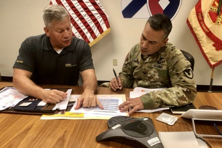 Retired Lt. Gen. Raymond Mason, Army Emergency Relief director (left), discusses updated AER processes to Fort Stewart-Hunter Army Airfield Garrison Commander, Col. Manny Ramirez (right), during a meet-and-greet session, July 20 at the Garrison Headquarters on Fort Stewart. During the visit, Mason explained the AER program and the importance of financial planning for Soldiers, Family members and Retirees across the Army.
