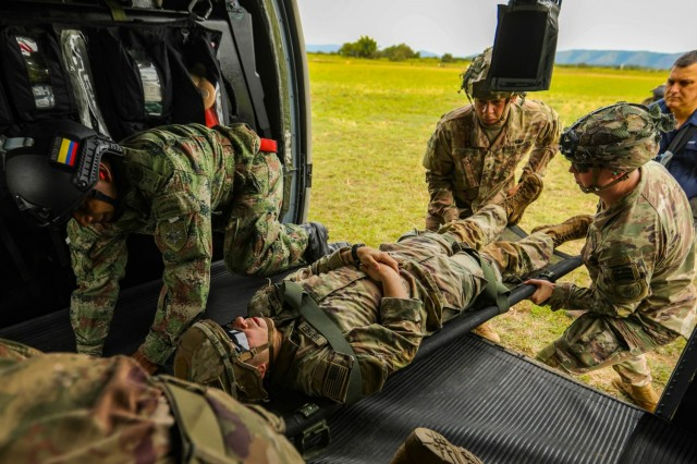 U.S. Army 82nd Airborne Division medics and a Colombian army combat medic conduct medical evacuation rehearsals in preparation for a combined airborne exercise July 24, 2021, at Tolemaida Air Base, Colombia. The U.S. Army and Colombian military conducted a Dynamic Force Employment airborne exercise, also known as Exercise Hidra II, involving jungle and water survival training, multiple airborne jumps and a field training exercise. (U.S. Army photo by Pfc. Joshua Taeckens)