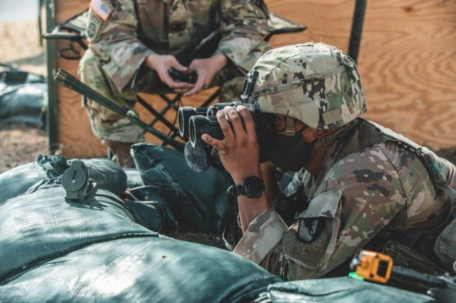 """A Trooper with 3rd Armored Brigade Combat Team, 1st Cavalry Division, sights a target during the patrolling portion of the coveted Expert Soldier Badge (ESB) and Expert Infantry Badge (EIB) qualification, Fort Hood, Texas, August 26, 2020. The ESB and EIB qualification tests the Soldiers knowledge on basic Infantry and basic Soldier skills. If they qualify, they will be awarded the title """"expert"""" in their field."""