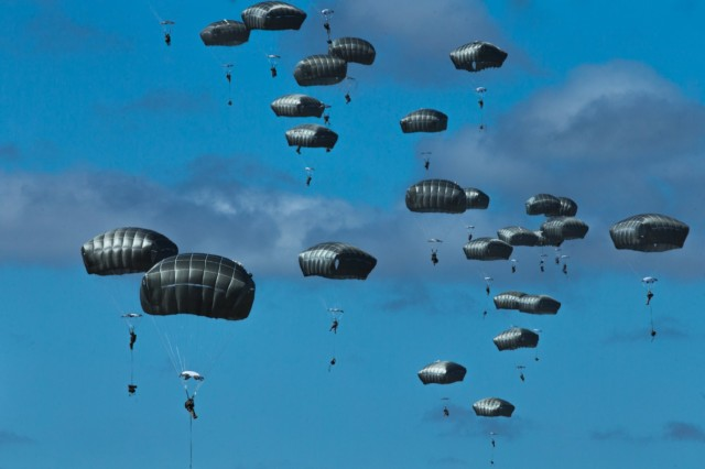 U.S. Army paratroopers with the 3rd Battalion, 509th Parachute Infantry Regiment, 4th Infantry Brigade Combat Team (Airborne), jump onto a drop zone as part of a simulated Joint Forcible Entry Operation during Exercise Talisman Sabre 21 in Charters Towers, Queensland, Australia, July 28, 2021. This event is part of a larger simulated JFEO overseen by the U.S. Army's 4th Infantry Division Forward Command Post acting as the Combined Land Forces Component Command headquarters for this portion of TS21. TS21 supports the U.S. National Defense Strategy by enhancing the ability to protect the homeland and provide combat-credible forces to address the full range of potential security concerns in the Indo-Pacific. (U.S. Marine Corps photo by Lance Cpl. Alyssa Chuluda)