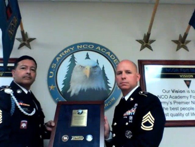 SFC James Teague (Chief Trainer, Fort McCoy NCO Academy) accepts the 2020 Lean Six Sigma Excellence Award for Process Improvement Non-Enterprise Level Green Belt Project on behalf of Fort McCoy, Non-Commissioned Officer Academy.