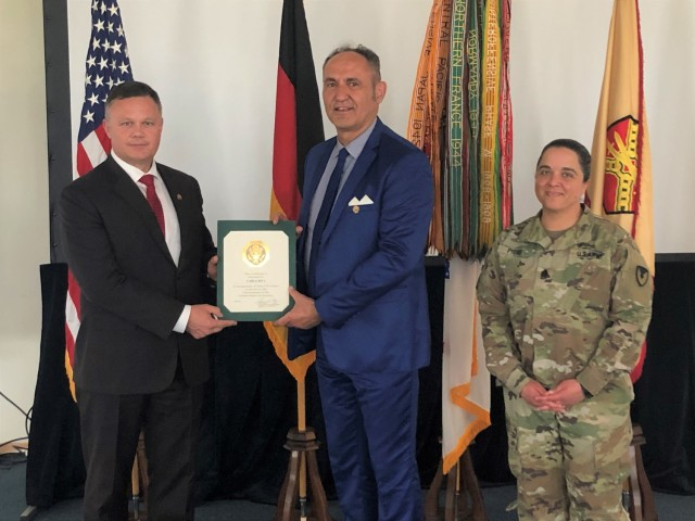 Carlo Riva, accident insurance specialist with Installation Management Command-Europe, receives recognition for 45 years of service to the U.S. Army. The certificate was presented by IMCOM-Europe Director Tommy Mize and Command Sgt. Maj. Samara Pitre.