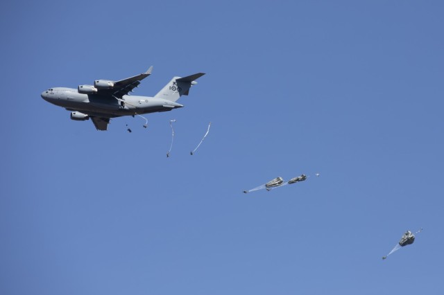 U.S. Army paratroopers with the 3rd Battalion, 509th Parachute Infantry Regiment, 4th Infantry Brigade Combat Team (Airborne), jump out of a Royal Australian Air Force C-17A Globemaster III onto a drop zone as part of a simulated Joint Forcible Entry Operation during Exercise Talisman Sabre 21 in Charters Towers, Queensland, Australia, July 28, 2021. A JFEO is a complex military operation that synchronizes multi-domain capabilities such as air, land, sea, information, space, cyberspace, and other domains to take possession of a key location in enemy territory and use it to introduce forces and capability to obtain military advantage enabling future operations. TS21 supports the U.S. National Defense Strategy by enhancing the ability to protect the homeland and provide combat-credible forces to address the full range of potential security concerns in the Indo-Pacific. (U.S. Army photo by Pfc. Matthew Mackintosh)