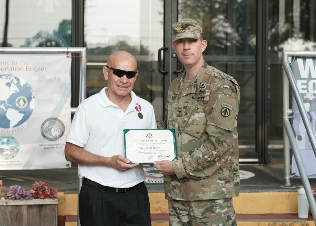 Col. Jeremy St. Laurent, commander, 597th Transportation Brigade, presented Tony Perez with the Meritorious Civilian Service Award during an award ceremony at Joint Base Langley-Eustis, Va. July 28.