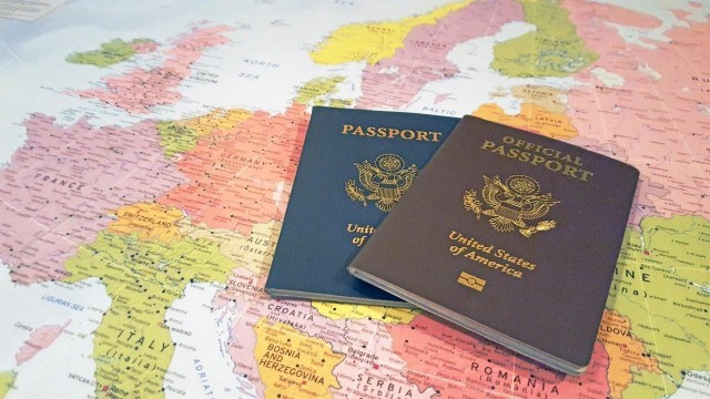 The Official No-Fee Passport (Brown), along with a Tourist (Blue) Passport.   (Courtesy Graphic)