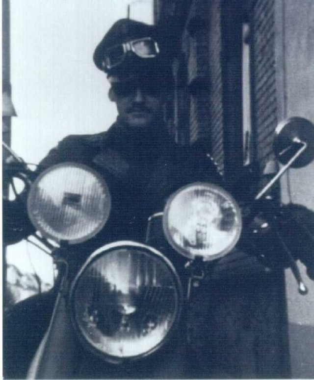 Carlo Riva rides a motorcycle in 1970s Germany. Riva, who left a life in several biker gangs in the early 80s, now uses his experiences to help others.