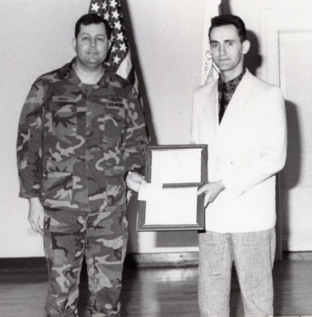 Carlo Riva receives a certificate of appreciation in 1988. Riva, who was born in Italy but moved to Germany as a child, began his career with the U.S. Army in 1975 in Worms, Germany. He plans to retire in 2022 with 47 years of service.