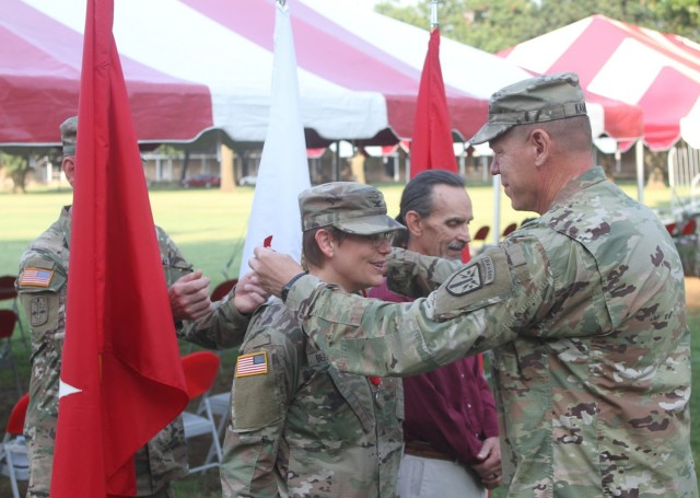 Maj. Gen. Ken Kamper, Fires Center of Excellence and Fort Sill commanding general, presents the Order of Saint Barbara medal to Col. Ann Behrends. The awards ceremony preceded the Fort Sill Dental Activity change of command July 29, 2021.