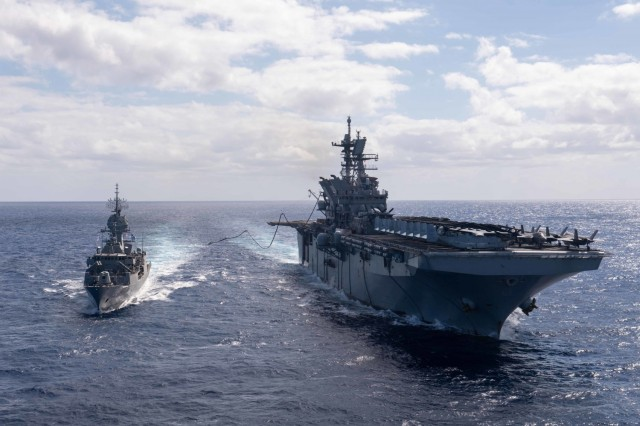 CORAL SEA (July 27, 2021) The forward-deployed amphibious assault ship USS America (LHA 6) conducts a fueling-at-sea with Royal Australian Navy frigate HMAS Ballarat (FFH 155) during Exercise Talisman Sabre 21. Australian and U.S. Forces combine biennially for Talisman Sabre, a month-long multi-domain exercise that strengthens allied and partner capabilities to respond to the full range of Indo-Pacific security concerns. (U.S. Navy photo by Mass Communication Specialist 3rd Class Matthew Cavenaile)