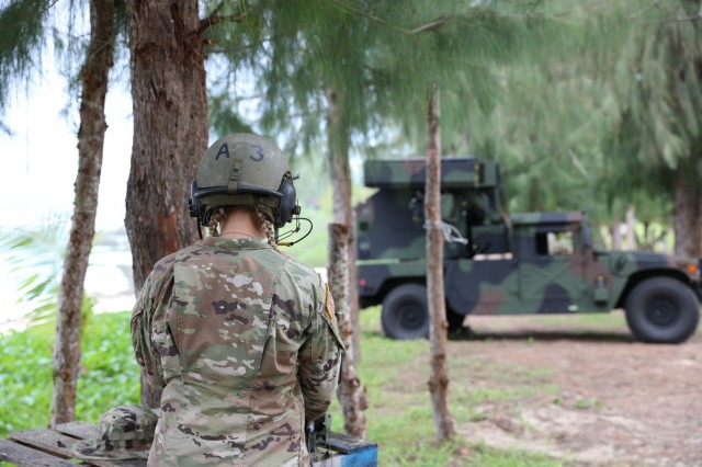 Ohio National Guard's Sgt. Saylor Knebel, assigned to Charlie Battery, 1st Battalion, 174th Air Defense Artillery Regiment, operates the Avenger Air Defense System remotely during exercise Forager 21 on July 30, 2021, Tinian, Northern Mariana Islands. The Avenger is a self-propelled surface-to-air missile system which provides mobile, short-range air defense protection for ground units. Exercise Forager 21 is an opportunity for U.S. Army Pacific to integrate innovation and experimentation across the multi-domain force in an archipelagic environment. (Photo by Army Spc. Olivia Lauer)