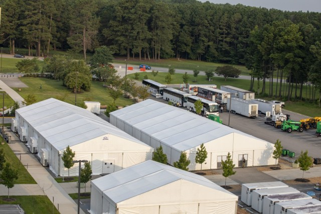 Buses transporting Afghan special immigrant applicants arrive from Dulles International Airport and reach the Holiday Inn Express hotel in support of Operation Allies Refuge, July 30, 2021 at Fort Lee, Virginia. The Department of Defense, in support of the Department of State, is providing transportation and temporary housing for Afghan special immigrant applicants recently relocated to the United States to complete the final steps of the immigration process. This initiative follows through on America's commitment to Afghan citizens who have helped the United States, and provides them essential support at secure locations outside Afghanistan, where they and their families can complete the Special Immigrant Visa process safely. (U.S. Army photo By Spc. Christopher Rodrigo)