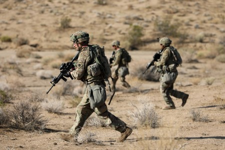 Soldiers with the 45th Infantry Brigade Combat Team, Oklahoma Army National Guard,  move through the desert during a live-fire exercise at the National Training Center in Fort Irwin, California, July 24, 2021. Members of the 45th IBCT participated in a live-fire exercise in the mountains of the Mojave Desert with the intention of increasing their proficiency.
