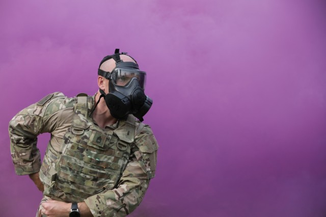 Sgt. 1st Class Tyler Price responds to a simulated chemical attack during the Army Materiel Command Best Warrior Competition in Camp Atterbury, Ind. July 25-28. Price was named AMC's noncommissioned officer of the year. (U.S. Army photo by Samantha Tyler)