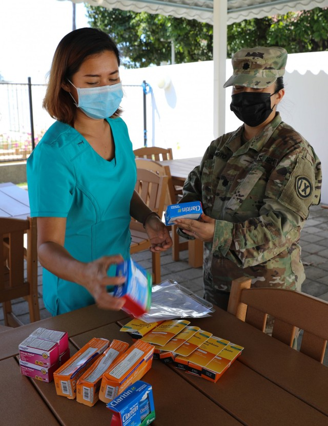 Lt. Col. Hope Hashimoto (right) reviews medical supplies with Elve Khadine D. Bandrang RN, the registered nurse assigned to the Health Unit at the U.S. Embassy in Timor-Leste on July 28, 2021. Timor-Leste is a remote island nation and medications common in American pharmacies cannot be found on the local market. (U.S. Army Reserve photo by Sgt. Teresa Cantero)