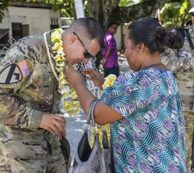U.S. Army Garrison-Kwajalein Atoll Commander Col. Thomas Pugsley, receives a wut marmar from an Enniburr resident during his first visit to the island July 24, 2021.