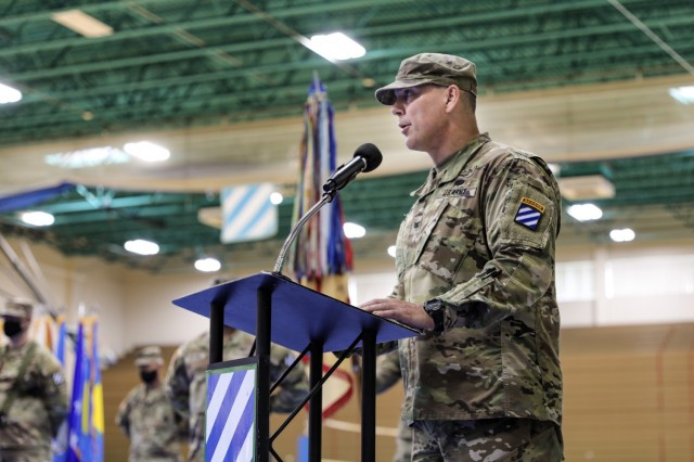"""U.S. Army Col. Trent D. Upton, commander of 1st Armored Brigade Combat Team """"Raider,"""" 3rd ID, speaks during Raider Brigade's uncasing ceremony August 3, 2021, on Fort Stewart, Georgia. The ceremony marked the official redeployment of the Brigade—known as the Battle Axe of the 3rd ID—after a nine month rotation to the Republic of Korea. (U.S. Army photo by Spc. Summer Keiser)"""