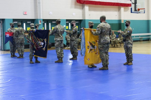 """Senior leaders assigned to 1st Armored Brigade Combat Team """"Raider,"""" 3rd Infantry Division, uncase their respective battalion colors during Raider Brigade's uncasing ceremony August 3, 2021, on Fort Stewart, Georgia. The ceremony marked the official redeployment of the Brigade—known as the Battle Axe of the 3rd ID—after a nine month rotation to the Republic of Korea. (U.S. Army photo by Staff Sgt. Daniel Guerrero)"""