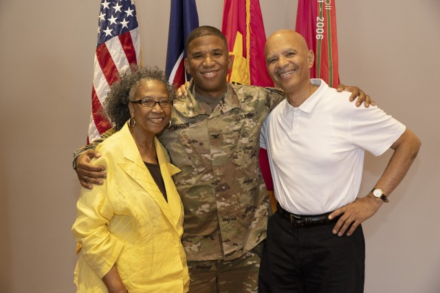 Col. Eric McCoy is flanked by his parents, Arlene and Andrew, at the change of command reception held at the depot's Berman-Varner House.