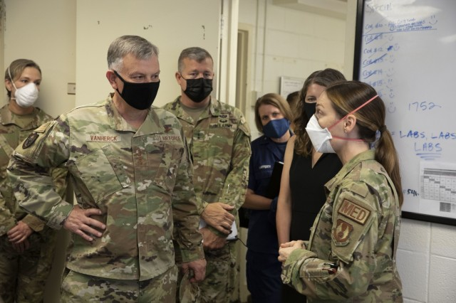 U.S. Air Force Gen. Glen VanHerck, commander of North American Aerospace Defense Command and U.S. Northern Command, receives a briefing from the Task Force Eagle medical support staff during his tour of the facilities being used in support of Operation Allies Refuge, Aug. 3, 2021, at Ft. Lee, Virginia. U.S. Northern Command in support of the Department of State, is the lead in providing transportation, medical screening and temporary housing for Afghan special immigrant applicants recently relocated to the United States to complete the final steps of the immigration process. This initiative follows through on America's commitment to Afghan citizens who have helped the United States, and provides them essential support at secure locations outside Afghanistan, where they and their families can complete the Special Immigrant Visa process safely. (U.S. Army photo by Cpl. Tommy L. Spitzer)