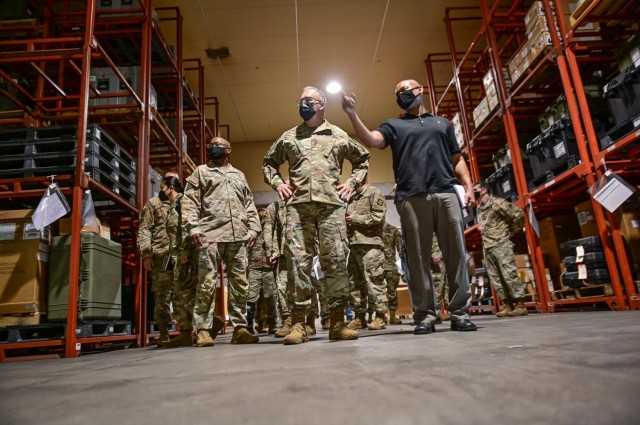 Maj. Gen. Michael L. Place, commanding general 18th Medical Command tours the U.S. Army's prepositioned stocks (APS4) at Sagami General Depot, Japan  June 21, 2021. The 2,500,000 sq. ft. facility in Sagamihara, Japan, provides a wide variety of medical equipment and supplies in support of the Joint force.  (U.S. Army Photo by Sgt. 1st Class Caleb Barrieau)