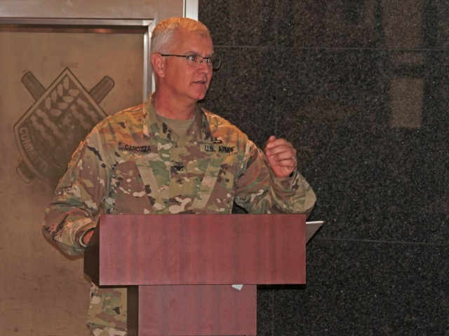 Col. Steven Carozza, U.S. Army Tank-automotive and Armaments Command chief of staff, delivers remarks during a Change of Command ceremony for the Headquarters and Headquarters Company at the Detroit Arsenal, Michigan Jul. 23.