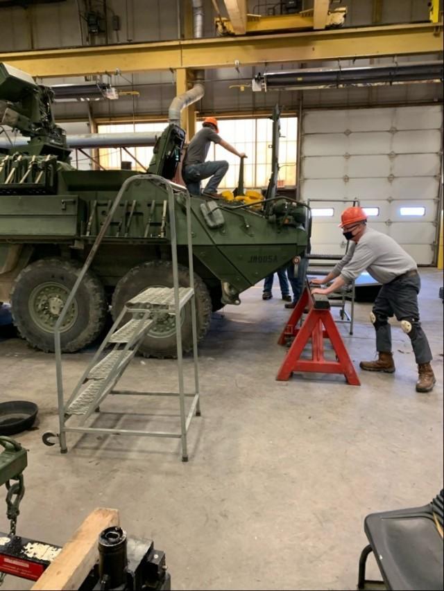 Wyatt Koehler (left) and Eric Dunken (right), Fort Leonard Wood Fleet Management Expansion, prepare a Stryker for an annual service check.