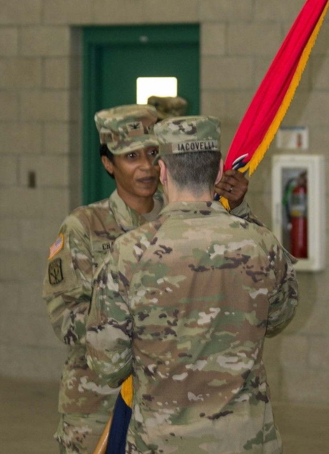Brig. Gen. Stephen Iacovelli, 94th Training Division-Force Sustainment commanding general, passes the brigade guidon to Col. Antionette Chase as she assumed command of the 1st Brigade (Quartermaster) on 16 May 2021 during the unit's change of command ceremony. Col. John Joseph, the outgoing brigade commander, relinquished command of  1st Brigade (Quartermaster) after a three-year tenure. Soldiers gathered at the Maj. Gen. Charles C. Rogers U.S. Army Reserve Center for the ceremony. (Photo courtesy of  1st BDE Unit Public Affairs Representative, 94th TD-FS)