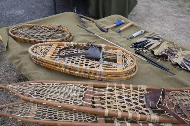 Lawrence W. Sandlin, a Marine Corps and Army retired veteran and living historian from Olympia, Wash., shares his vast collection of snowshoes and climbing tools that the 10th Mountain Division used during World War II at the Lewis Army Museum reopening at Joint Base Lewis-McChord, July 31, 2021.  The 10th Mountain Division used the Bear Paw Snowshoes to trek through the mountain in Italy during World War II (U.S. Army photo by Spc. Nicole Nicolas).