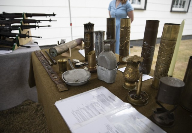 Alli Krisco, a living historian from Spanaway, WA displays Trench Art at the Lewis Army Museum reopening at Joint Base Lewis-McChord, Wash., July 31, 2021. Many soldiers during World War I created art pieces using artillery shells to pass the time (U.S. Army photo by Spc. Nicole Nicolas).