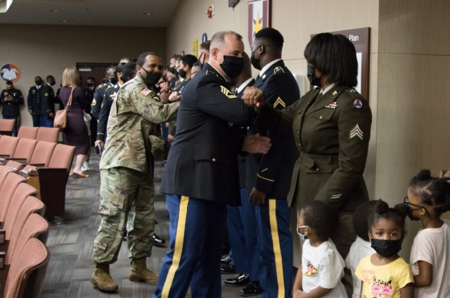 Soldiers and family members congratulate noncommissioned officers assigned to 3rd Expeditionary Sustainment Command following a noncommissioned officer induction ceremony, Aug. 5, 2021, on Fort Bragg, North Carolina. Forty-nine soldiers were inducted during the ceremony.