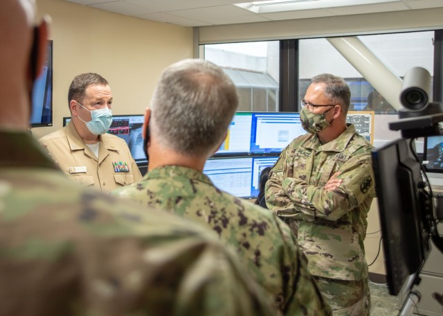 SAN DIEGO (Oct. 21, 2020) Army Maj. Gen. Michael Place, 18th Medical Command's (MEDCOM) (Deployment Support) commander (right), tours Naval Medical Center San Diego's (NMCSD) Joint Tele-Critical Care Network operations center Oct. 21. Place is traveling to military hospitals around the country, visiting with leadership to discuss the future of military medicine, since taking command of the 18th MEDCOM (DS) earlier this year. The 18th MEDCOM (DS) is an expeditionary medical command that ensures readiness and coordinates medical functions in integrated, multi-domain joint force operations. NMCSD's mission is to prepare service members to deploy in support of operational forces, deliver high quality healthcare services and shape the future of military medicine through education, training and research. NMCSD employs more than 6,000 active duty military personnel, civilians, and contractors in Southern California to provide patients with world-class care anytime, anywhere. (U.S. Navy photo by