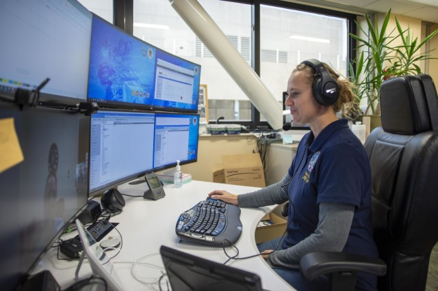 SAN DIEGO (Sept. 17, 2020) Trisha Lindsey, a nurse specialist assigned to Naval Medical Center San Diego's (NMCSD) Joint Tele-Critical Care Network (JTCCN), provides support to a remote intensive care unit (ICU) via tele-confrence in the hospital's JTCCN office Sept. 17. The JTCCN provides critical-care support to remote, bedside intensivist teams, known as spoke sites, via state-of-the-art audiovisual communication and computer systems. The coronavirus (COVID-19) pandemic has changed the way many facets of healthcare are conducted, and NMCSD has adapted some of its techniques and practices to keep both staff and patients safe while delivering the high-quality healthcare they've come to expect. NMCSD's mission is to prepare service members to deploy in support of operational forces, deliver high quality healthcare services and shape the future of military medicine through education, training and research. NMCSD employs more than 6,000 active duty military personnel, civilians and contract