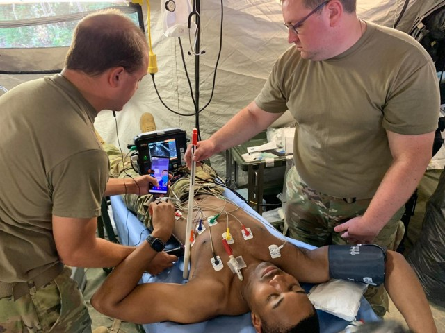 Soldiers from the 126th Forward Resuscitative Surgical Detachment (FRSD) test new medical equipment during exercise Garuda Shield in Bataraja, Indonesia Aug, 2, 2021. The FRSD exercised the Joint Tele-Critical Care Network using the Tempus Pro, BATDOK, OmniCure and communication software platforms. The practice session was extremely successful despite minimal bandwidth; images and live video were sent out via MiFi puck. Both physician and nursing staff at the JTCCN location were able to clearly visualize all facets of care being supported including a FAST exam.