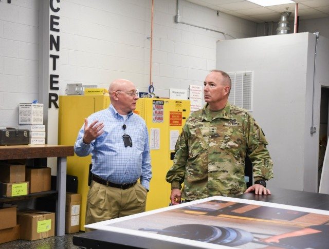 Maj. Gen. Daniel J. Christian, deputy chief of staff, U.S. Army Training and Doctrine Command, takes a tour with Enterprise Multimedia Center manager. This tour was in recognition of the EMC's outstanding efforts during the 2021 Remember the Fallen event.