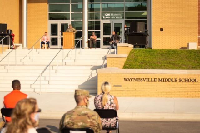 Maj. Gen. James Bonner, Maneuver Support Center of Excellence and Fort Leonard Wood commanding general, speaks at the dedication ceremony to open the upgraded Waynesville Middle School.