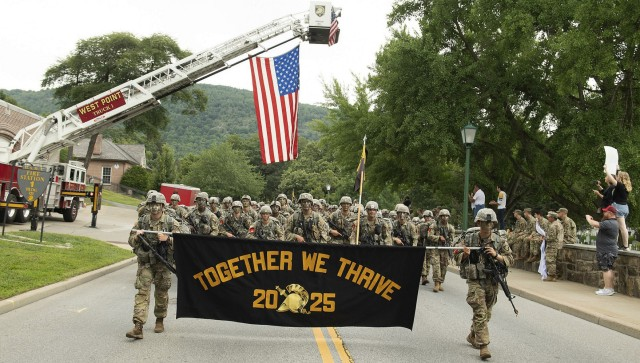 """Members of the U.S. Military Academy Class of 2025 proudly display their motto, """"Together We Thrive,"""" as they complete the final leg of a 12-mile road march from Lake Frederick to central area Monday during March Back, signifying the successful completion of Cadet Basic Training."""
