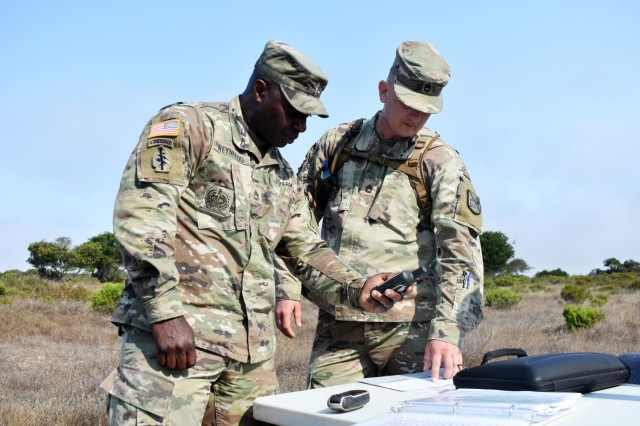 Sgts. 1st Class Aaron Reynolds, left, and Michael Turner, assigned to the 229th Military Intelligence Battalion, confirm grid coordinates before the start of battalion's land navigation competition at Fort Ord National Monument, Calif., Aug. 7., 2021.