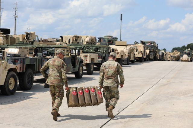Soldiers assigned to 3rd Brigade Combat Team, 101st Airborne Division (Air Assault) transport fuel containers onto the Fort Campbell Railhead August 10th in preparation for their Sea Emergency Deployment Readiness Training Exercise. SEDRE's provide Soldiers the opportunity to hone in on an additional capability to win the fight.
