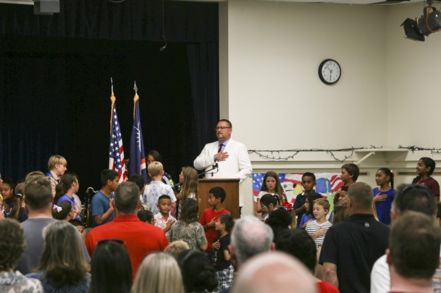 Kwajalein School System Head of School Paul Uhren, center, leads parents and students in the Pledge of Allegiance during the November 2020 Kwajalein School System Veterans Day Ceremony at the Davye Davis Multi-Purpose Room on U.S. Army Garrison-Kwajalein Atoll.