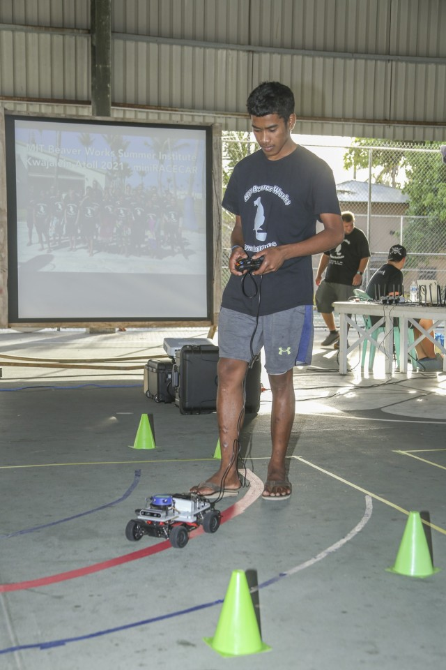 Ebeye high school student Jesse Mote drives his team car through a checkpoint during the pre-finale testing period for the Massachusetts Institute of Technology  Lincoln Laboratory Beaver Works Summer Institute - Autonomous RACECAR Grand Prix Aug. 2, 2021. High school students from Ebeye and Kwajalein showcased technological teamwork and coding skills for parents and friends at the Jabro Sports Complex following the culmination of the multi-week summer institute.