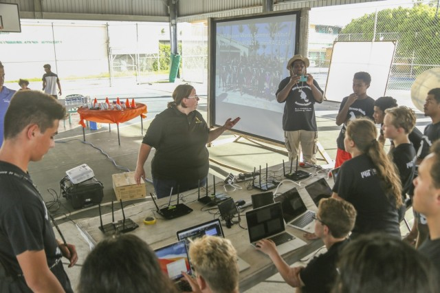 A pre-event pep talk: Massachusetts Institute of Technology, Lincoln Laboratory program advisor Dr. Sarah Willis addresses Ebeye and Kwajalein high school student participants in the Beaver Works Summer Institute - Autonomous RACECAR Grand Prix finale at the Jabro Sports Complex on Ebeye Aug. 2, 2021. The students showcased their talents after completing the multi-week intensive summer program.